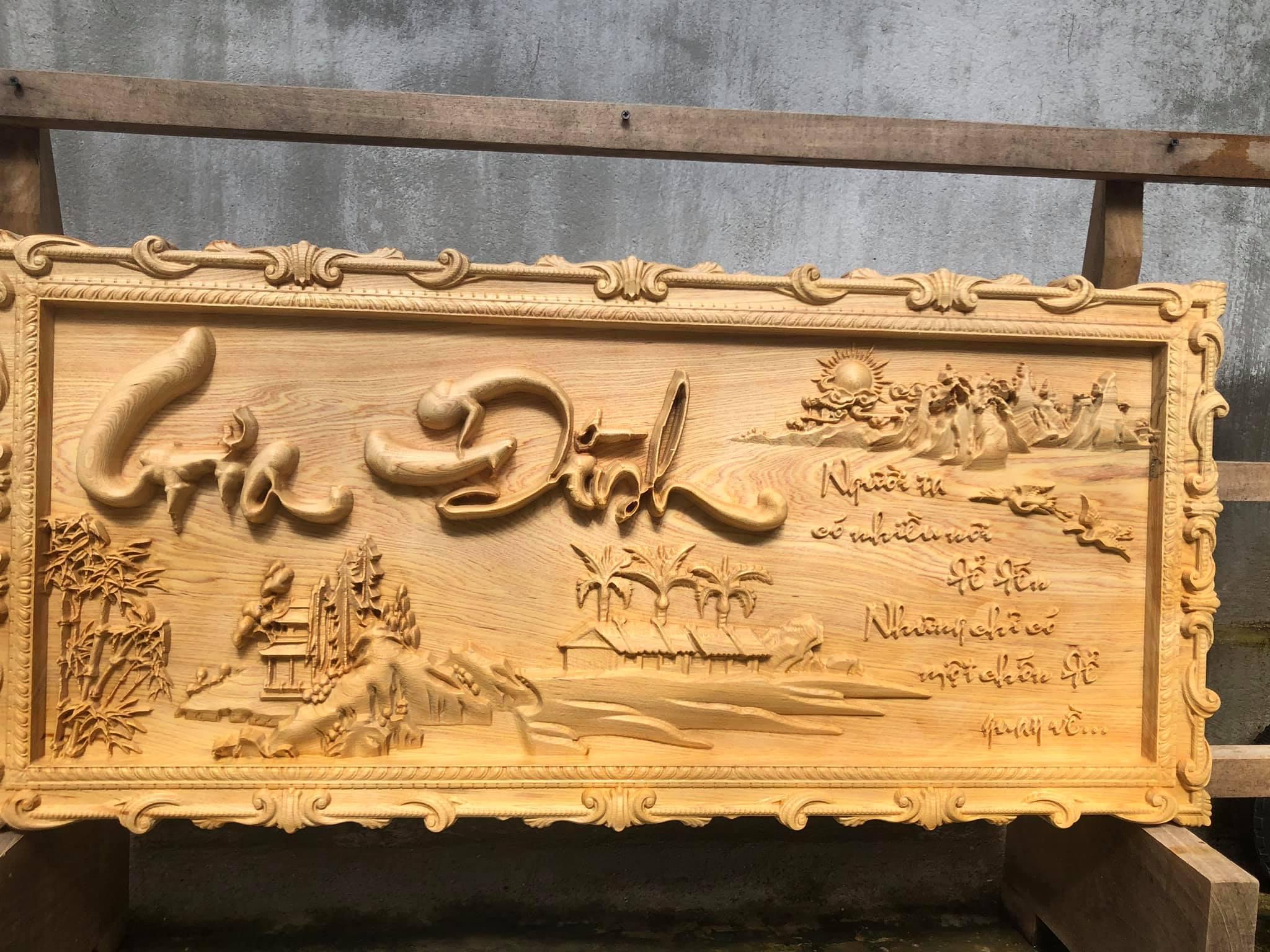 Tranh gia đình gỗ pơmu
